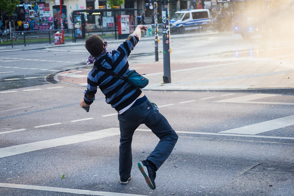 Rioter throwing Stones